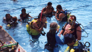 PADI Instructor with their students in the pool